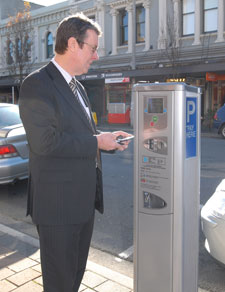 Mayor Garry Moore uses the first of Christchurchs new Pay-and-Display parking machines start working in High Street.