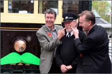 Mayor Garry Moore celebrating Movember. Putting a moustache on one a Christchurch Tram to advertise Mo-vember. Participants known as Mo Bros grow and groom their moustache during November and along the way raise as much money and awareness about male health issues as possible.