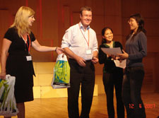 Mayor Garry Moore, in China, presenting the winner's prize for a Wuhan, China, high school student essay writing competition sponsored by Education Christchurch and the Wuhan Education Bureau. The essay topic was 'Why I want to go to New Zealand.