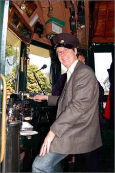 Mayor driving Tram 178 as it circumnavigated the city centre for the 100,000 time.