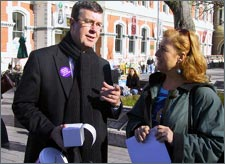Mayor Garry Moore helps Women's Refuge by collecting donations in Cathedral Square.